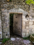 door ajar in a stone wall