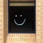 smiley face on a window